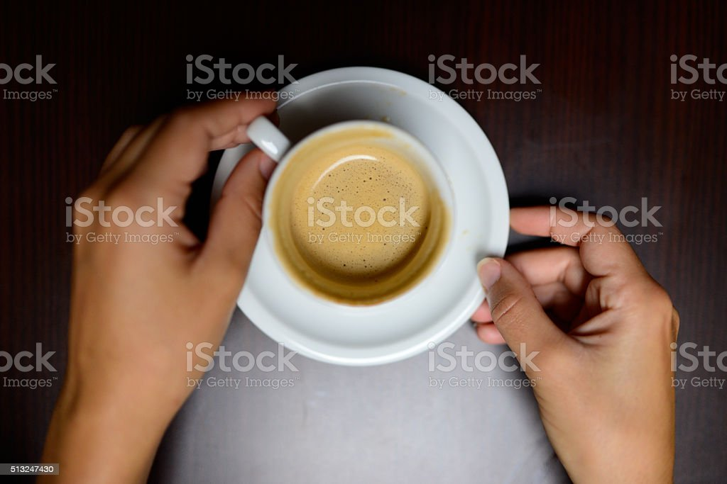 Taking coffee stock photo