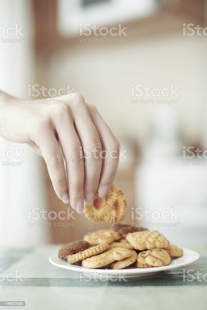 Taking cookie stock photo
