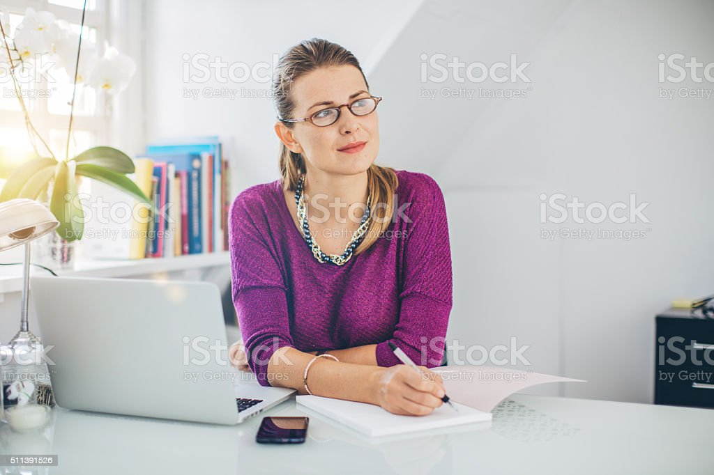 Taking down some important notes stock photo