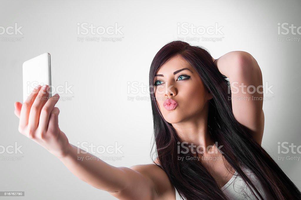 Taking duck face selfie stock photo