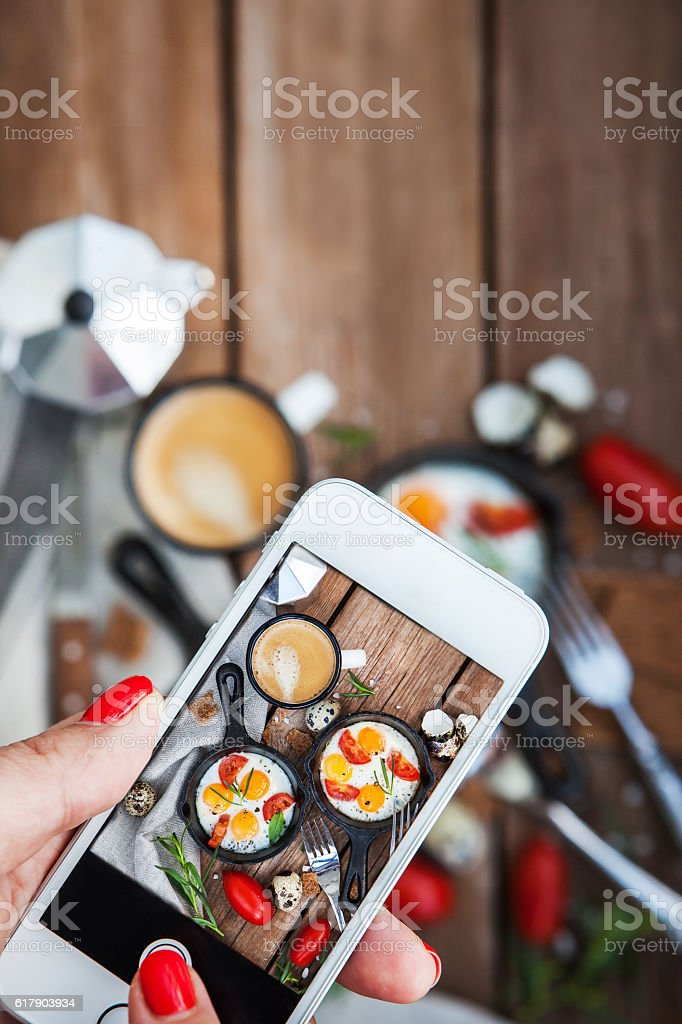 Taking food photo of breakfast with fried eggs stock photo