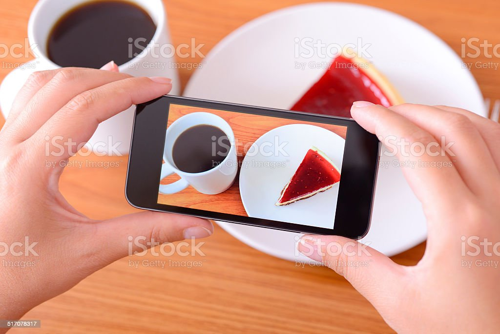 Taking food photo with smart phone stock photo