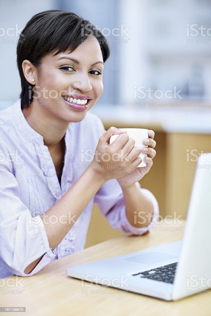 Taking her coffee break to do some browsing royalty-free stock photo