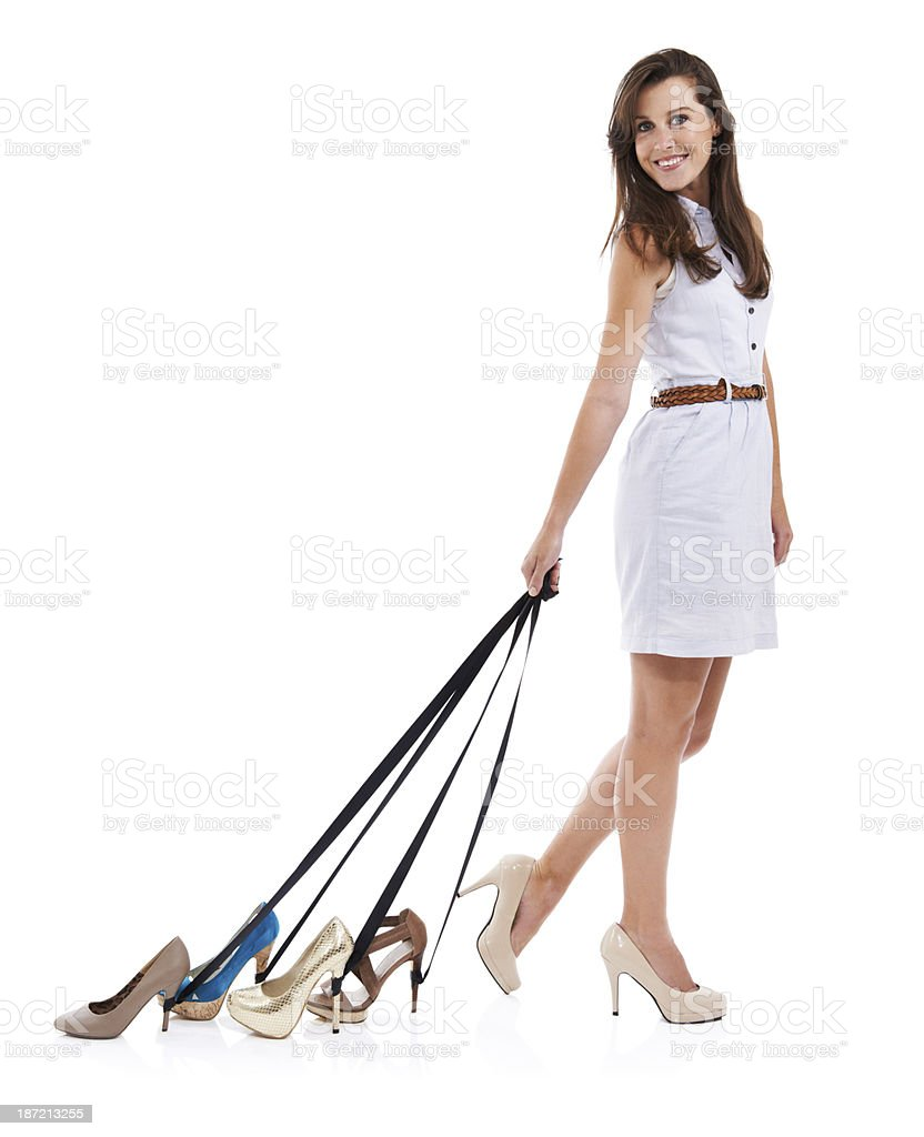 Taking her shoes out for a walk royalty-free stock photo