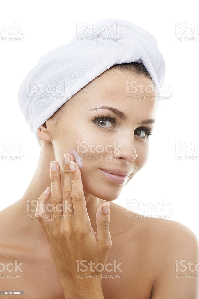 Taking her skincare seriously royalty-free stock photo