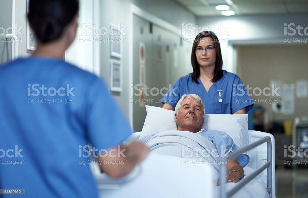 Taking him through to O.R. stock photo