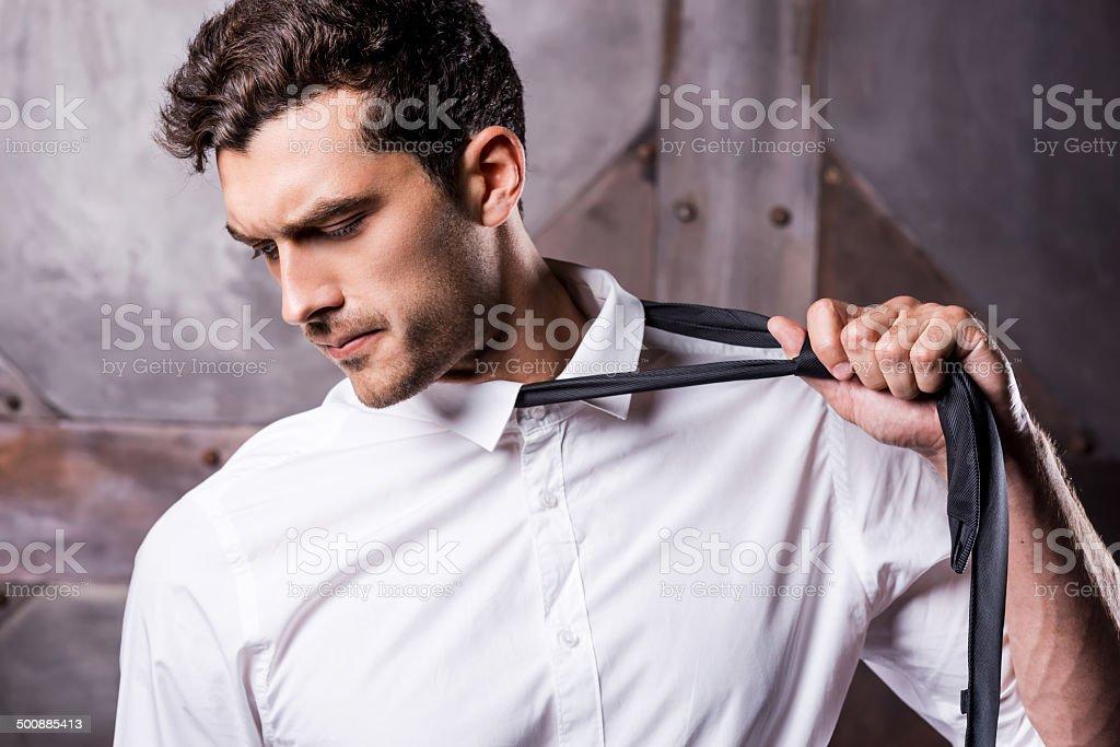Taking his necktie away. stock photo