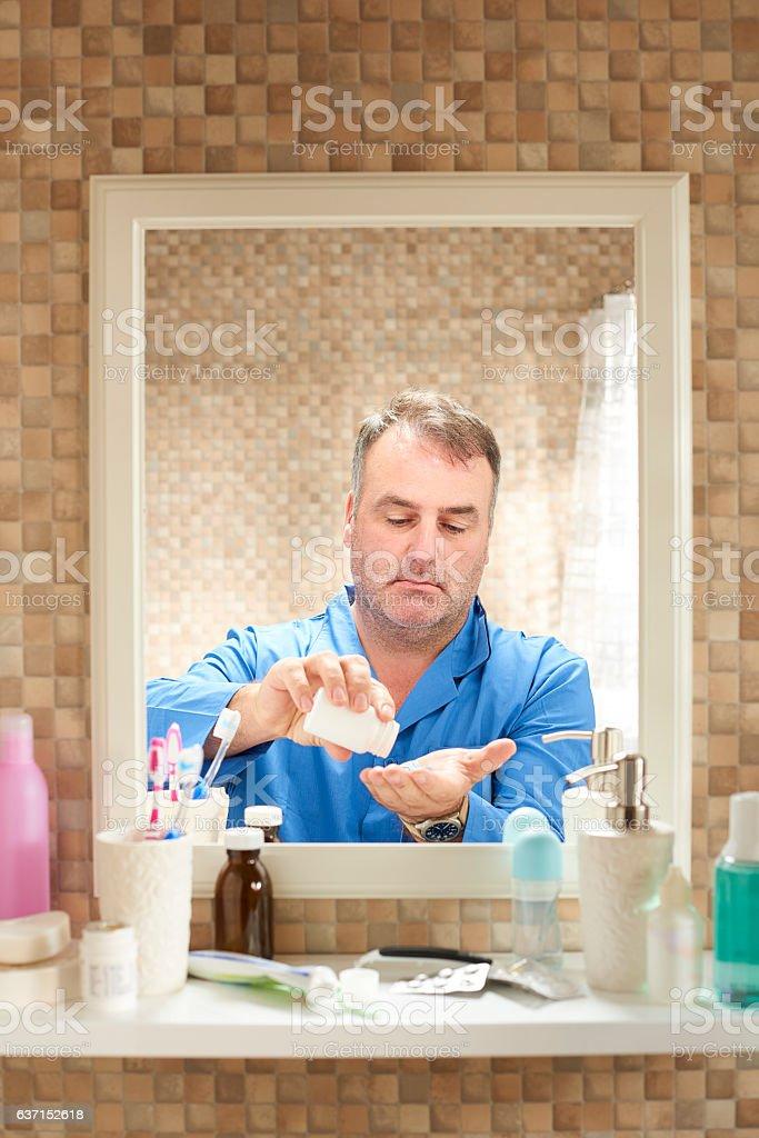 taking his vitamins stock photo