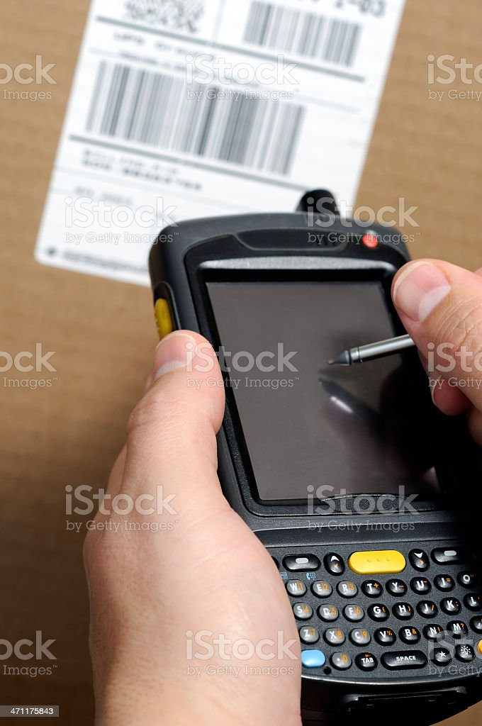 Taking Inventory with a Handheld Computer Barcode Scanner stock photo
