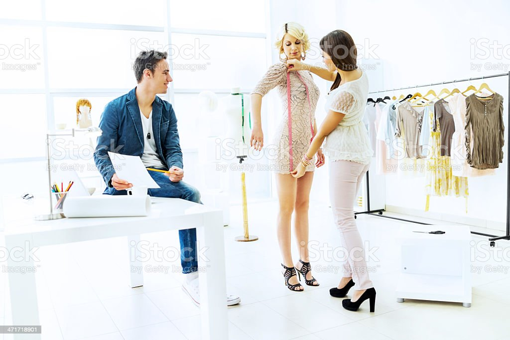 Taking measurements in the clothing design studio. royalty-free stock photo