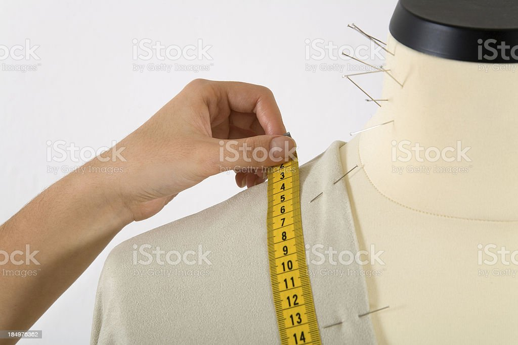 Taking measures on a mannequin royalty-free stock photo