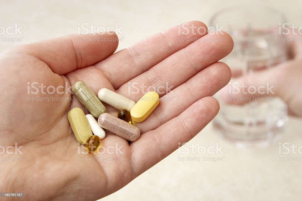 Taking Natural Supplements for Health. royalty-free stock photo