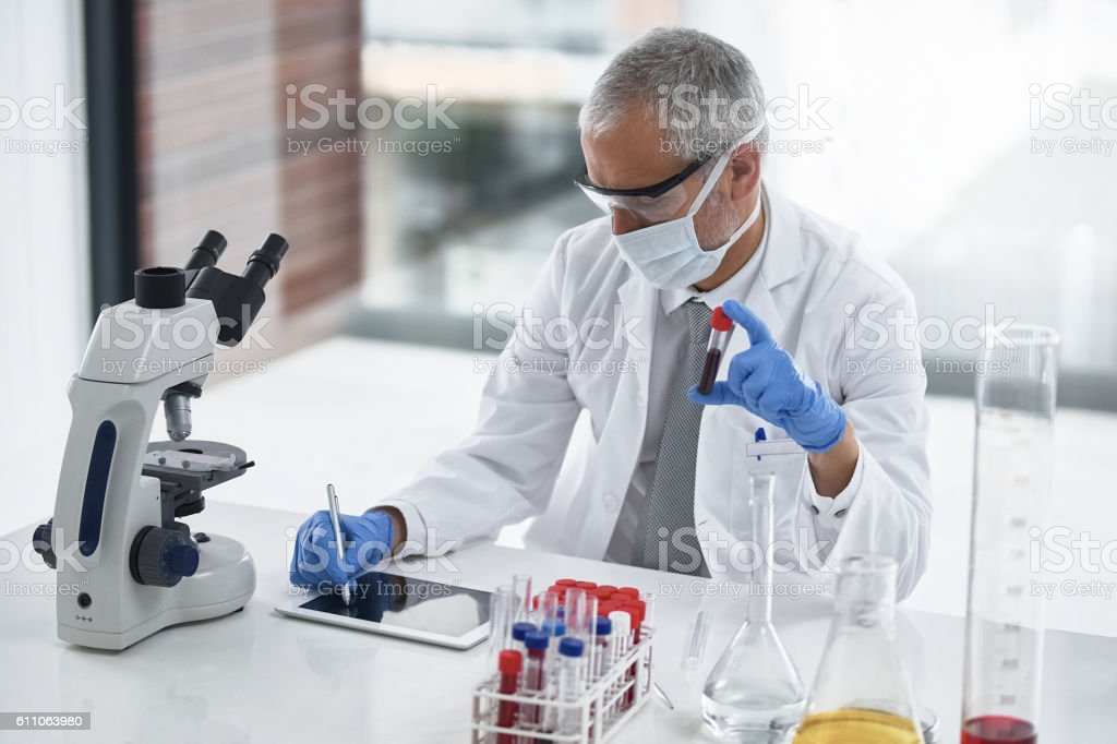 Taking note of a worthwhile test stock photo