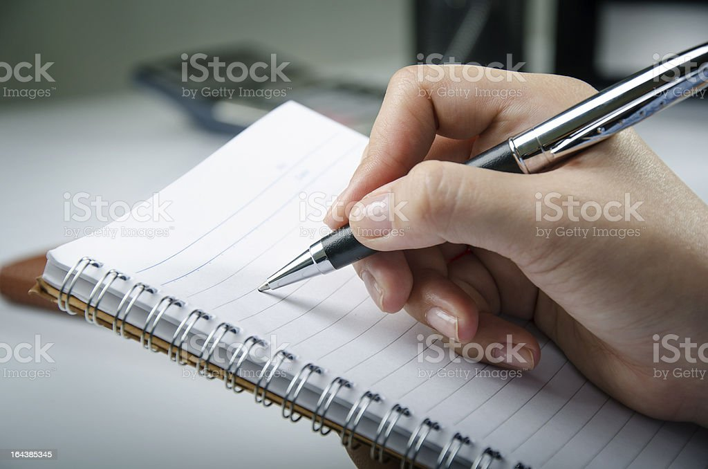 Taking note royalty-free stock photo