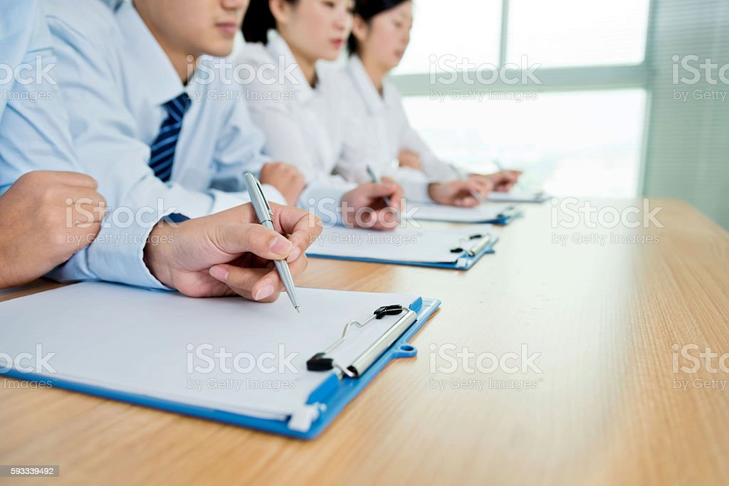 Taking notes at conference stock photo