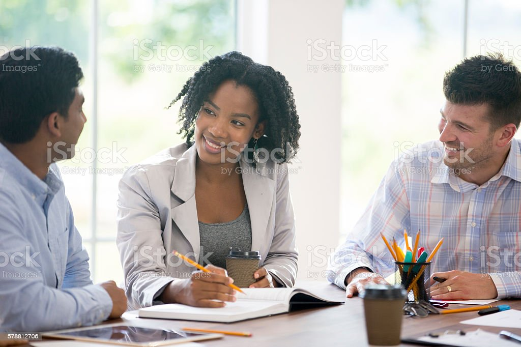 Taking Notes During a Team Meeting stock photo