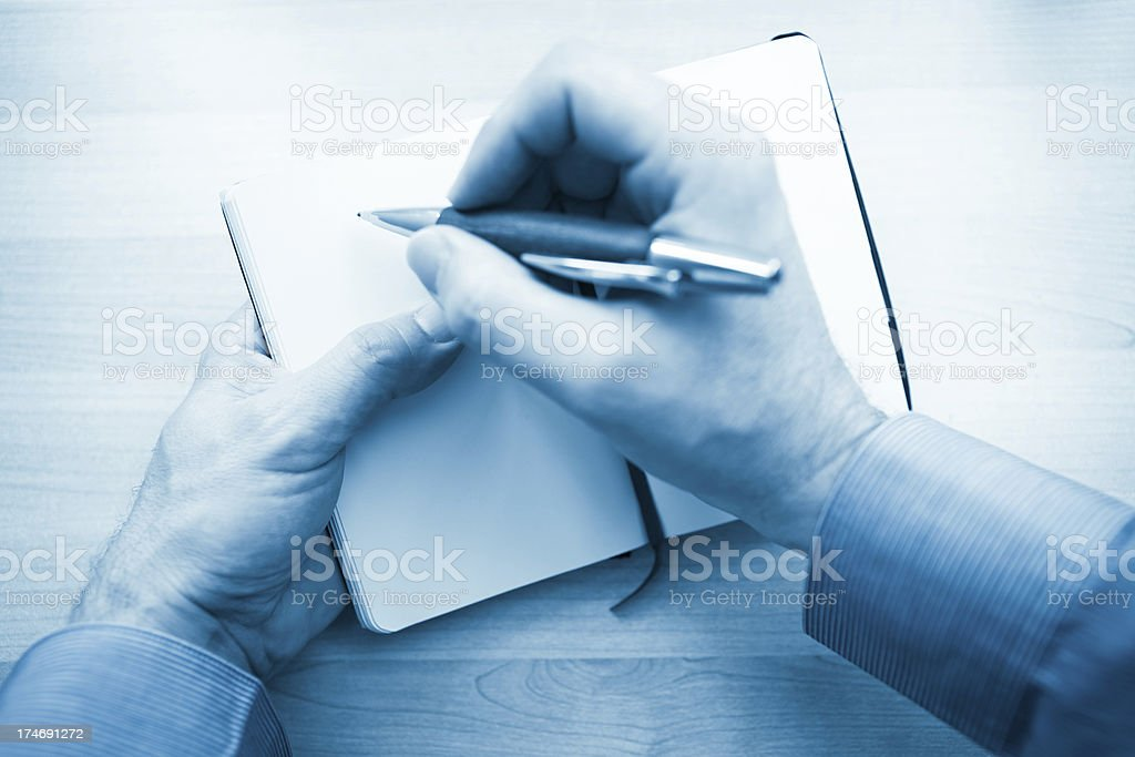 Taking notes during an interview stock photo