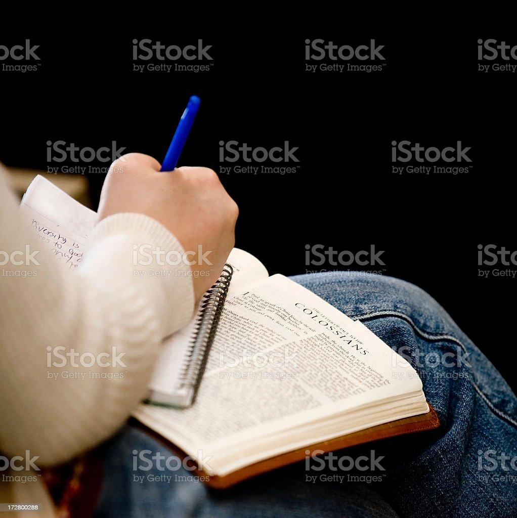 taking notes in church stock photo
