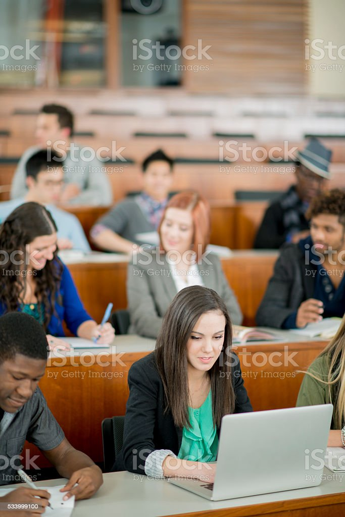 Taking Notes on a Laptop stock photo