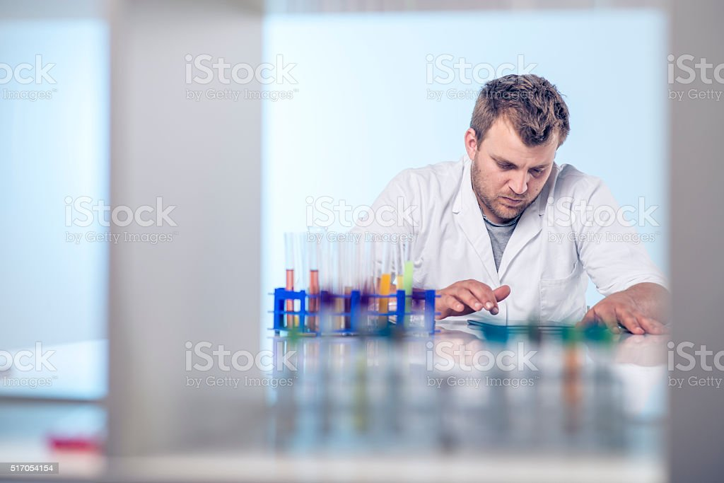 Taking notes on digital tablet stock photo