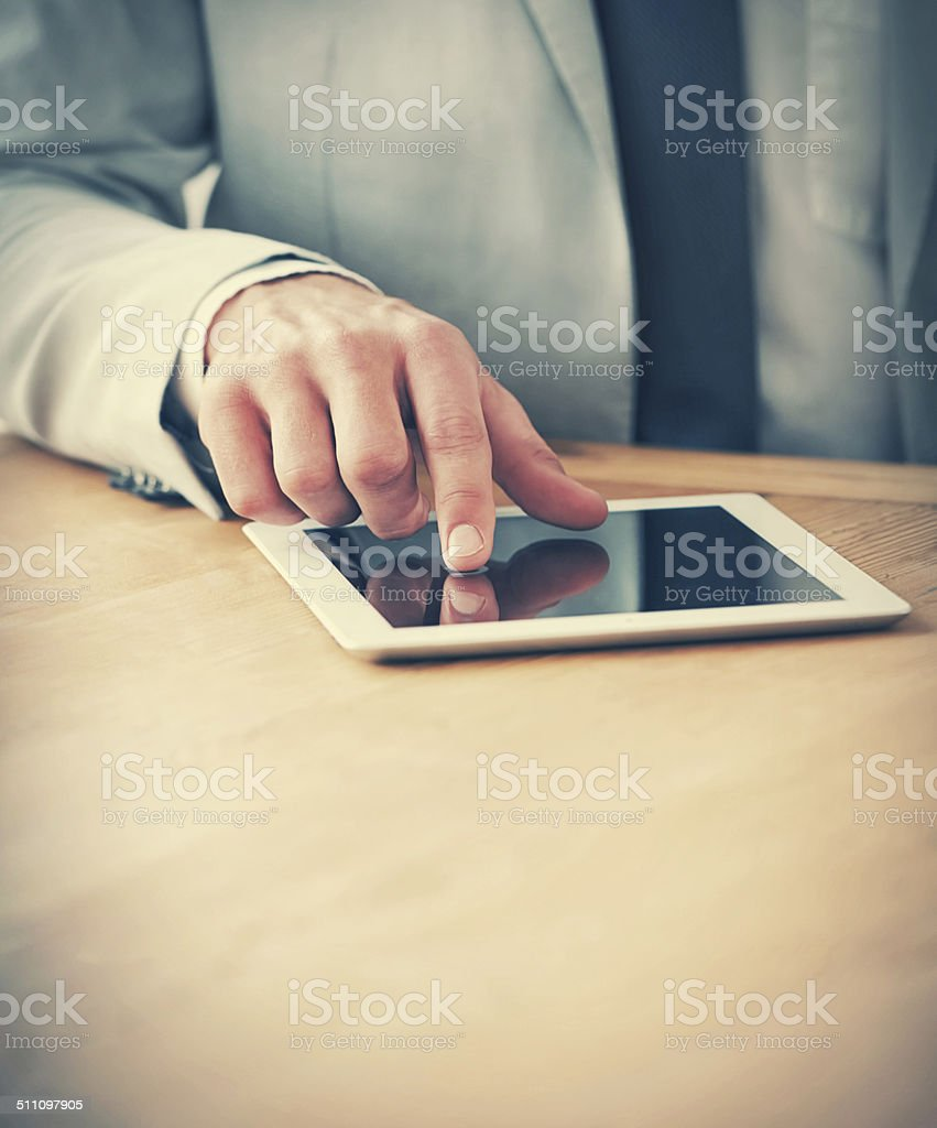 Taking notes on his digital tablet stock photo