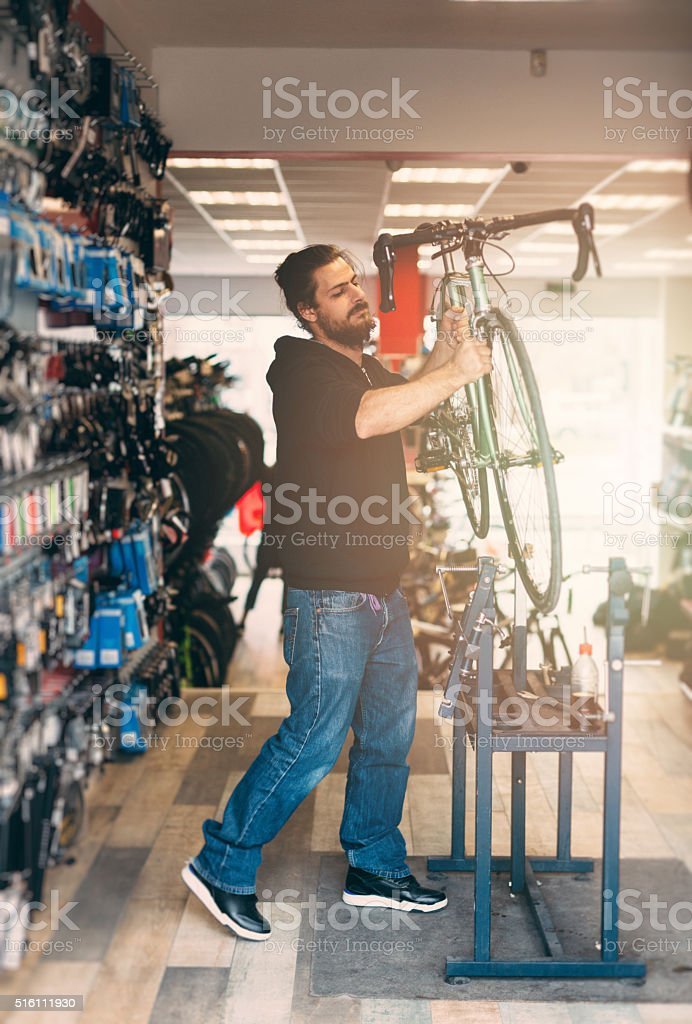 Taking off a bicycle from a stand after a repair stock photo