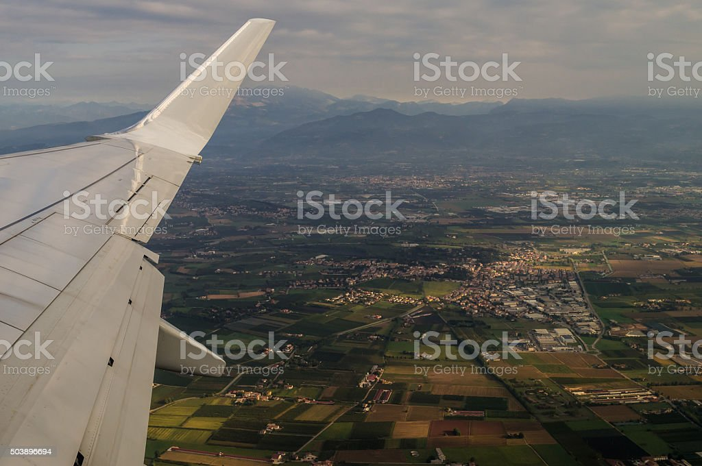 Taking off Aerial View on Verona from Aircraft Porthole stock photo