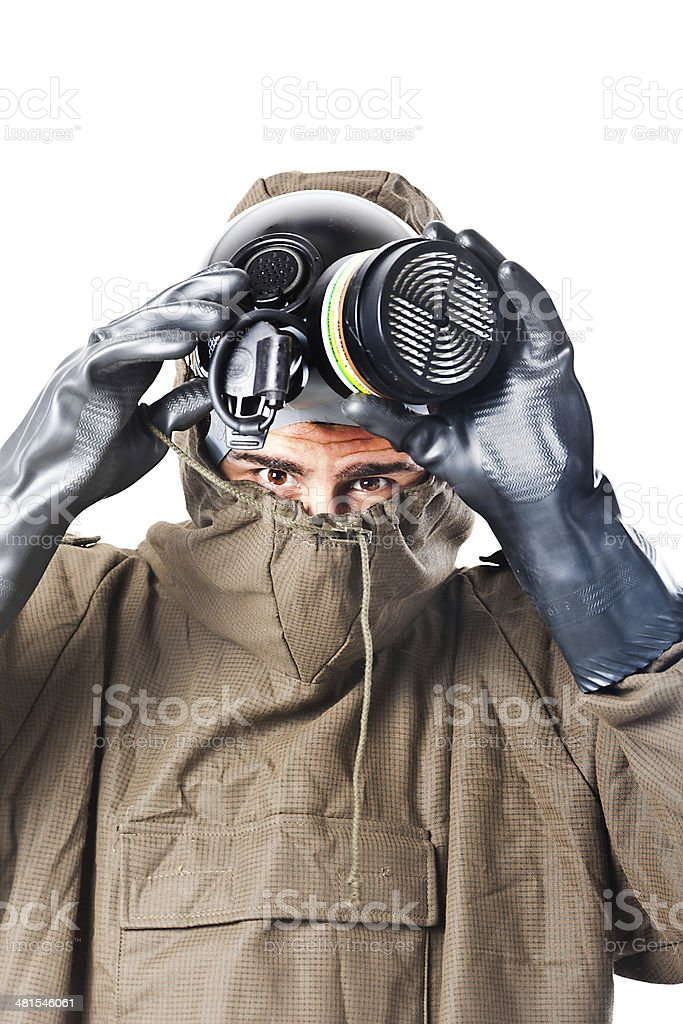 Taking off the gas mask stock photo
