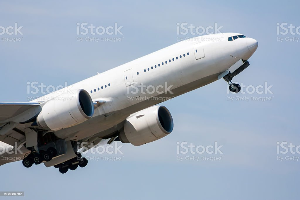Taking off wide body plane and retracting the landing gear royalty-free stock photo
