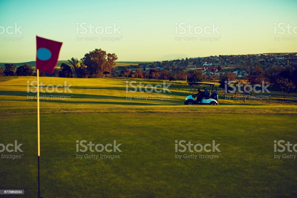Taking one tee at a time stock photo