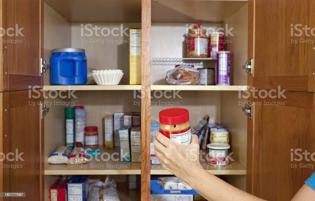 Taking Peanut butter out of the Food Pantry stock photo