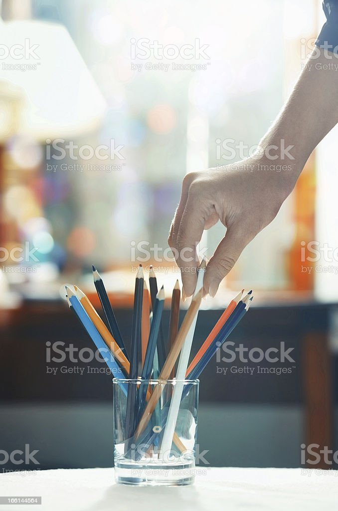 Taking pencil stock photo