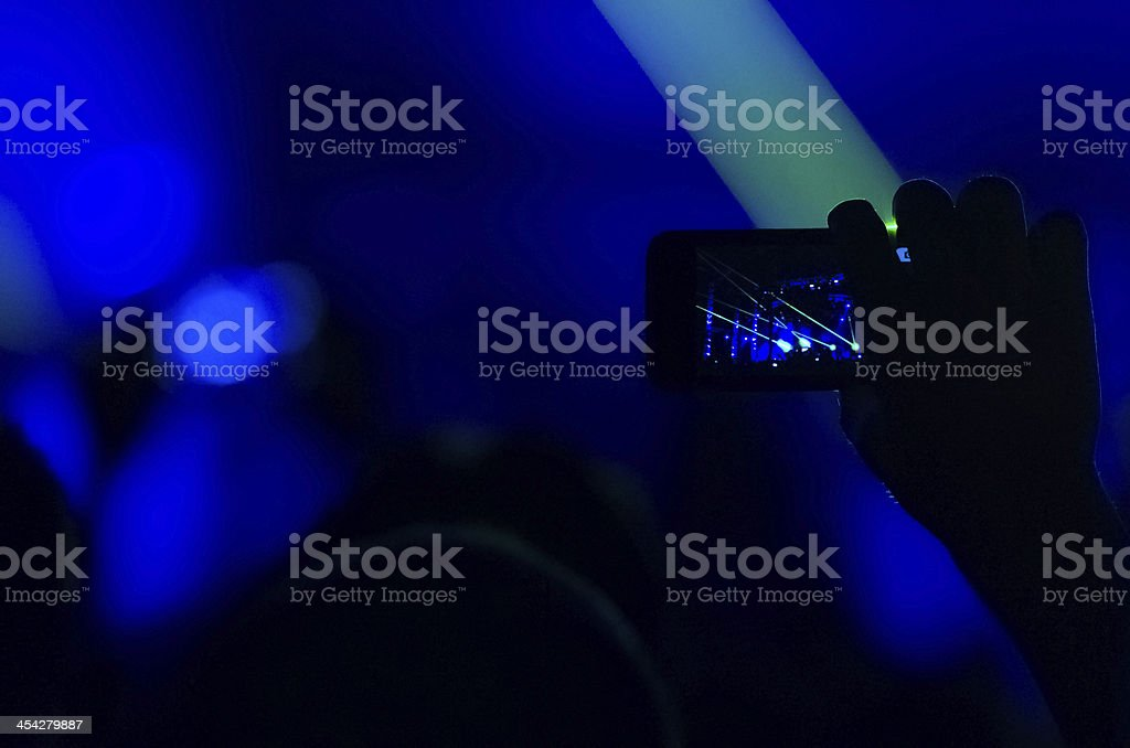 Taking photo at concert royalty-free stock photo