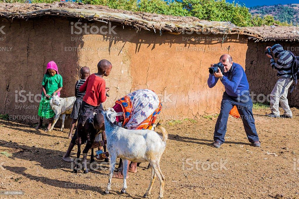 Taking photo at Masai Village stock photo