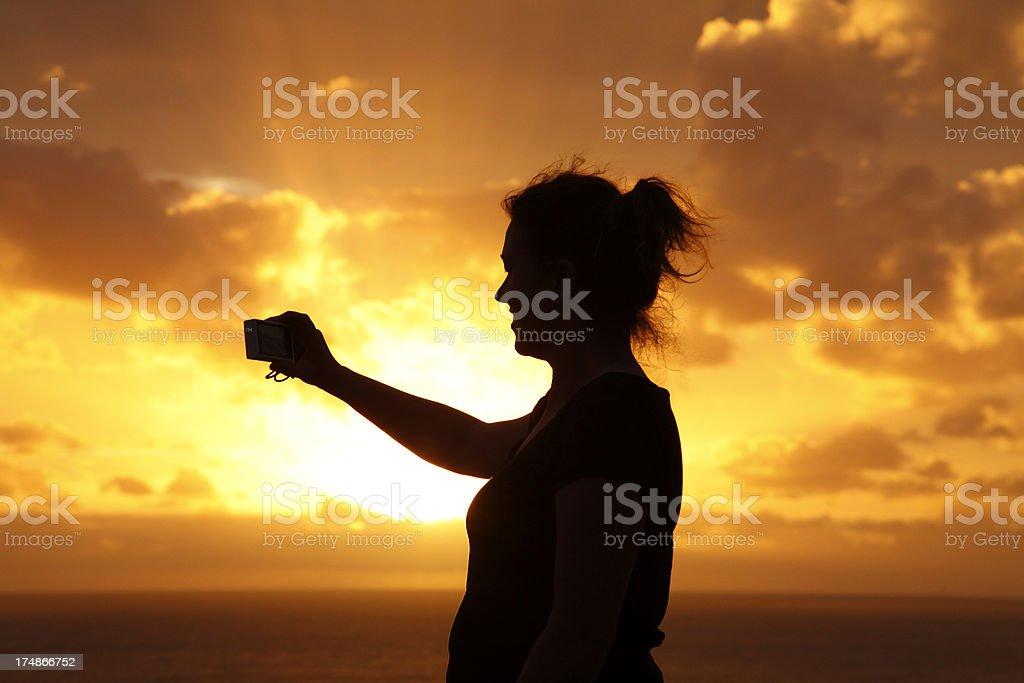 Taking Photo at Sunset stock photo