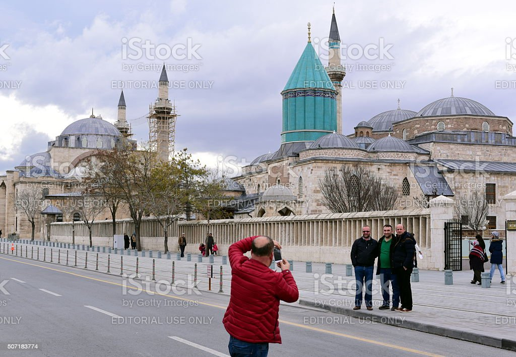 Taking photo in front of Mevlana Museum - Konya stock photo