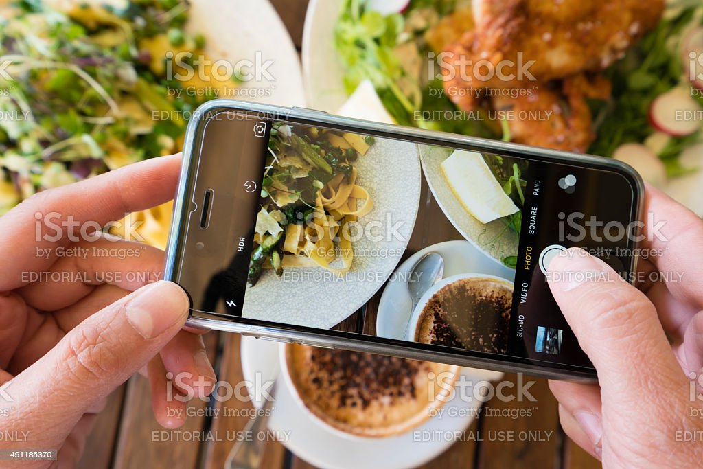 Taking photo of a meal using smartphone stock photo