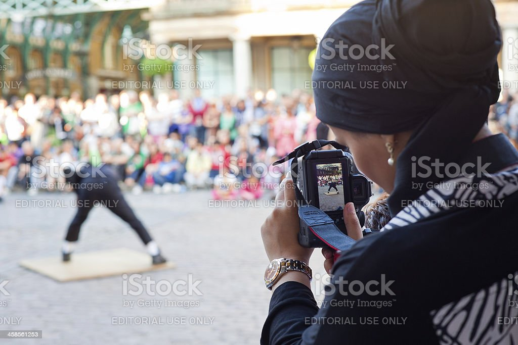 Taking Photo of a Street Artist stock photo