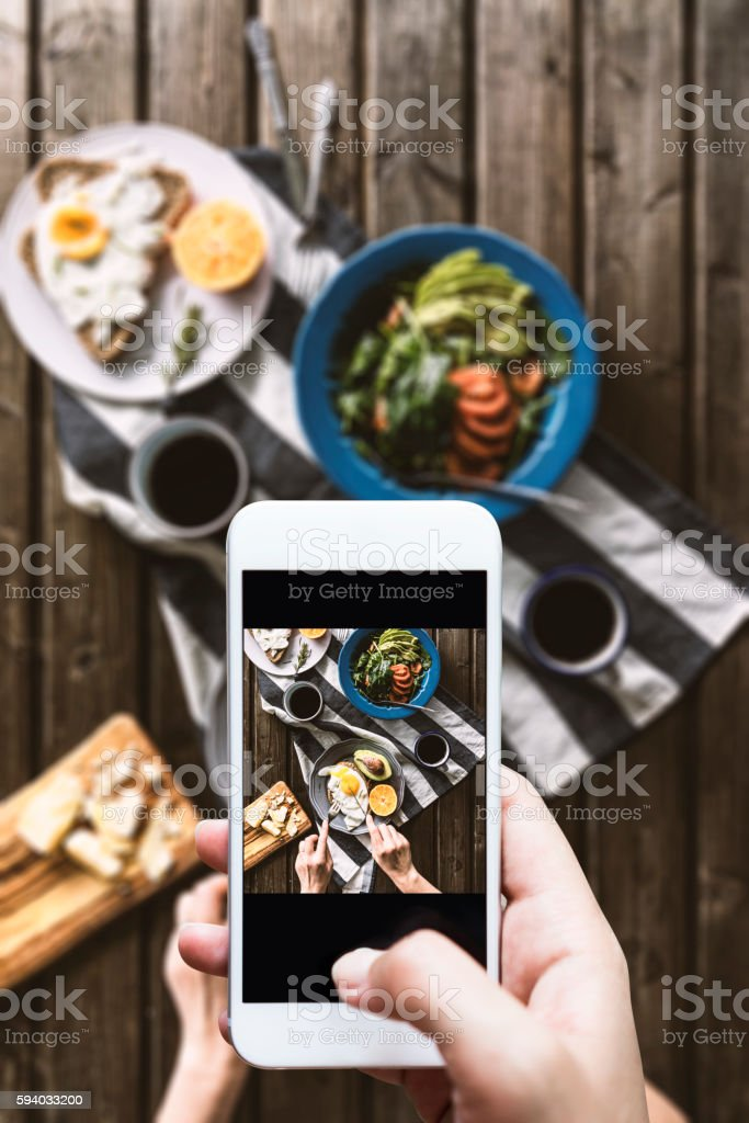 Taking photo of breakfast table stock photo