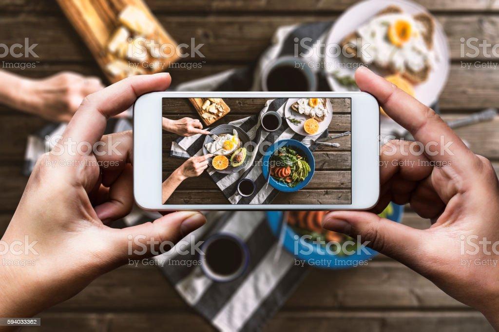 Taking photo of breakfast table stock photo