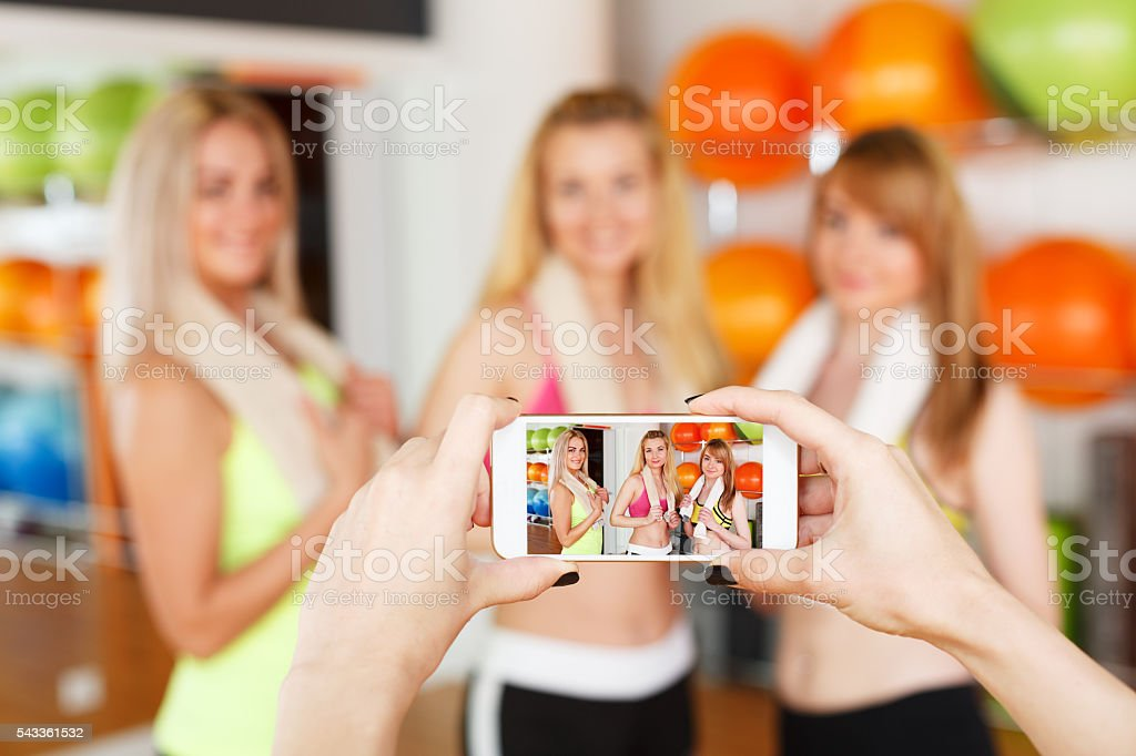 Taking photo of girlfriends. POV image, smartphone screen stock photo