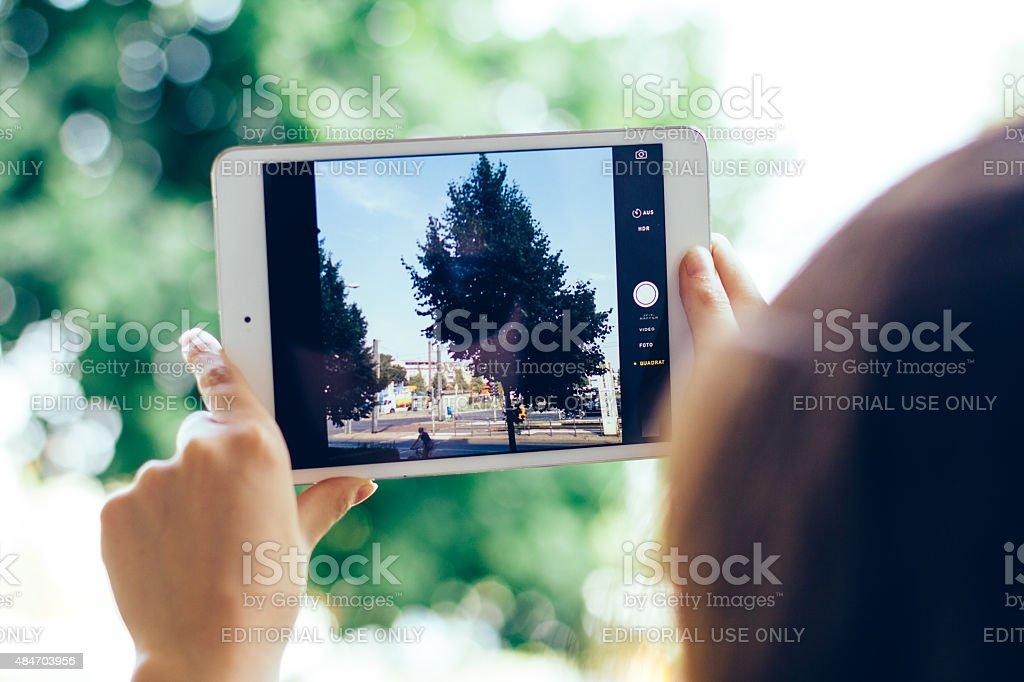 taking photo with ipad stock photo
