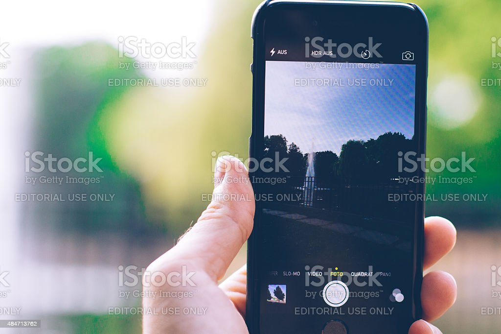 Taking Photo with iPhone 6 stock photo