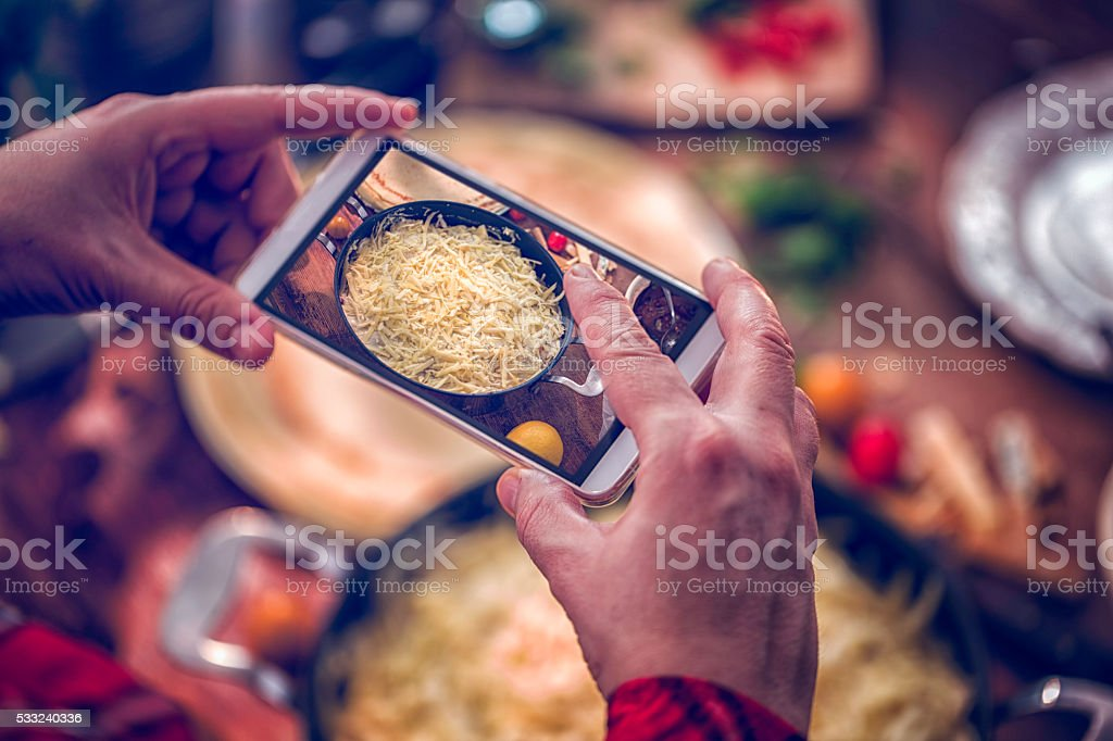 Taking Photo with Smarthphone of Crepes with Ham and Tomatoes stock photo