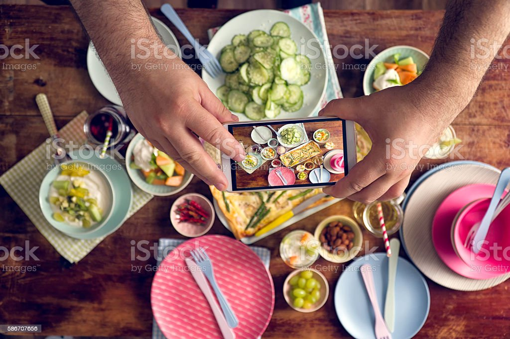 Taking Photo with Smartphone of Healthy Vegetarian Summer Dishes stock photo