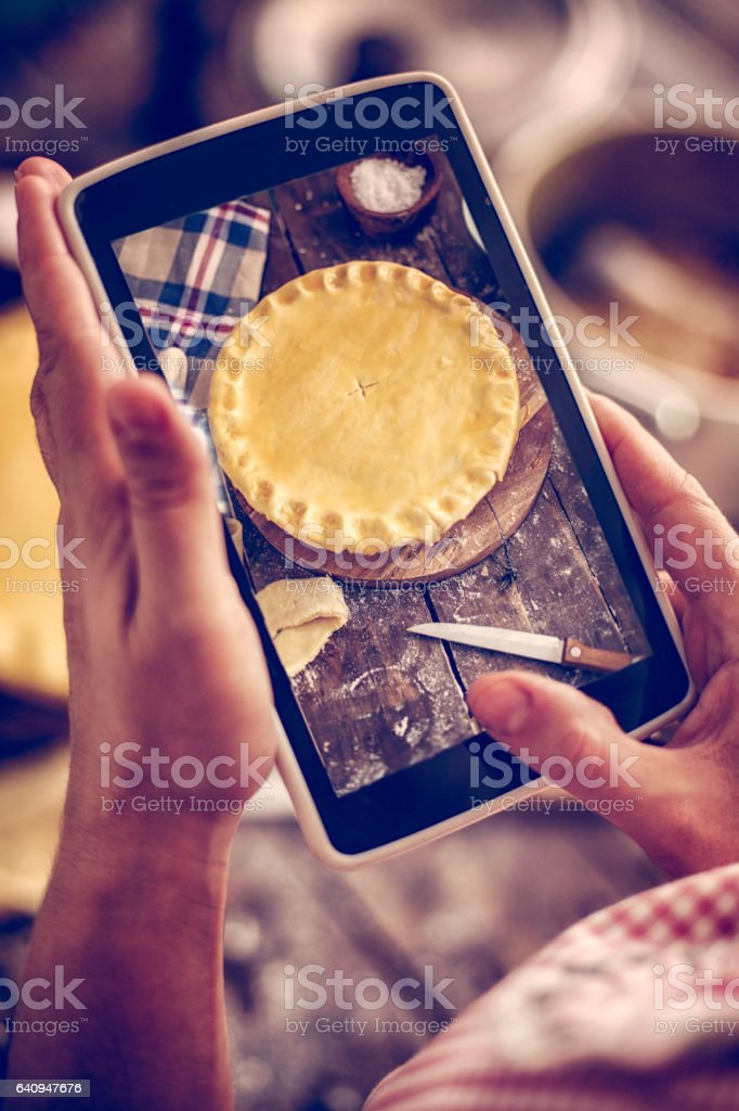 Taking Photo with Smartphone of Homemade Chicken Meat Pie stock photo