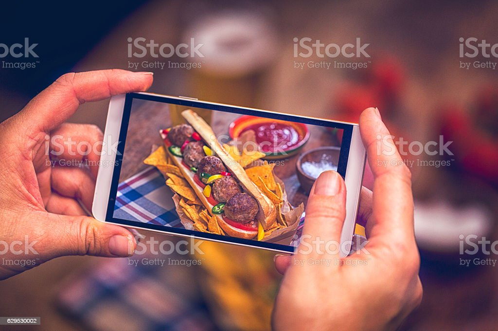 Taking Photo with Smartphone of Mexican Meatball Sandwich stock photo
