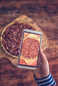 Taking Photo with Smartphone of Pecan Pie Baked for Holidays