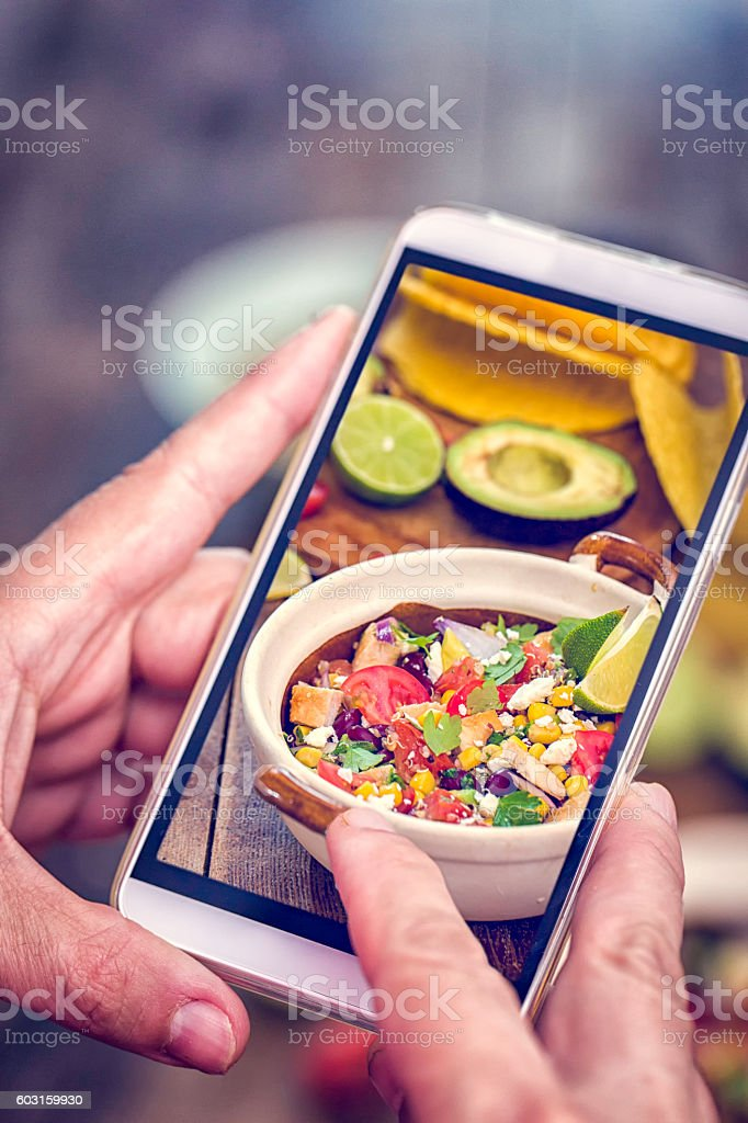 Taking Photo with Smartphone of Quinoa Chicken Chipotle stock photo