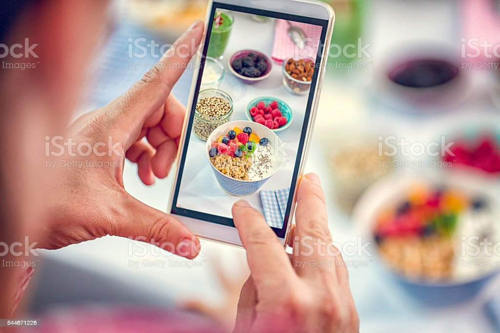 Taking Photo with Smartphone of Short Grained Rice with Yoghurt stock photo